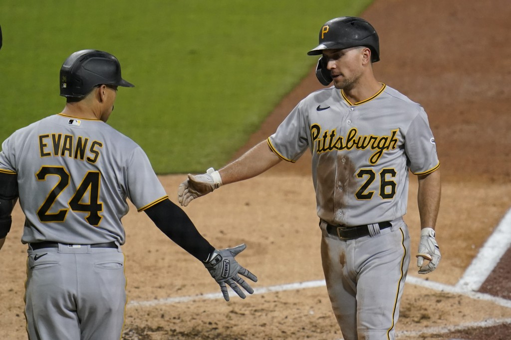 Pittsburgh Pirates' Adam Frazier (26) is greeted by teammate Phillip Evans (24) after scoring off an RBI double by Bryan Reynolds during the third inn...