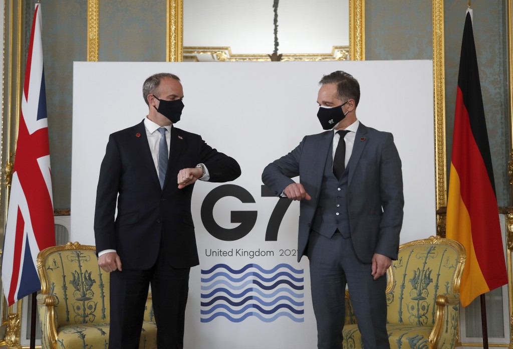Britain's Foreign Secretary Dominic Raab, left, poses for a photo with his German counterpart Heiko Maas ahead of bi-lateral talks during the G7 forei...