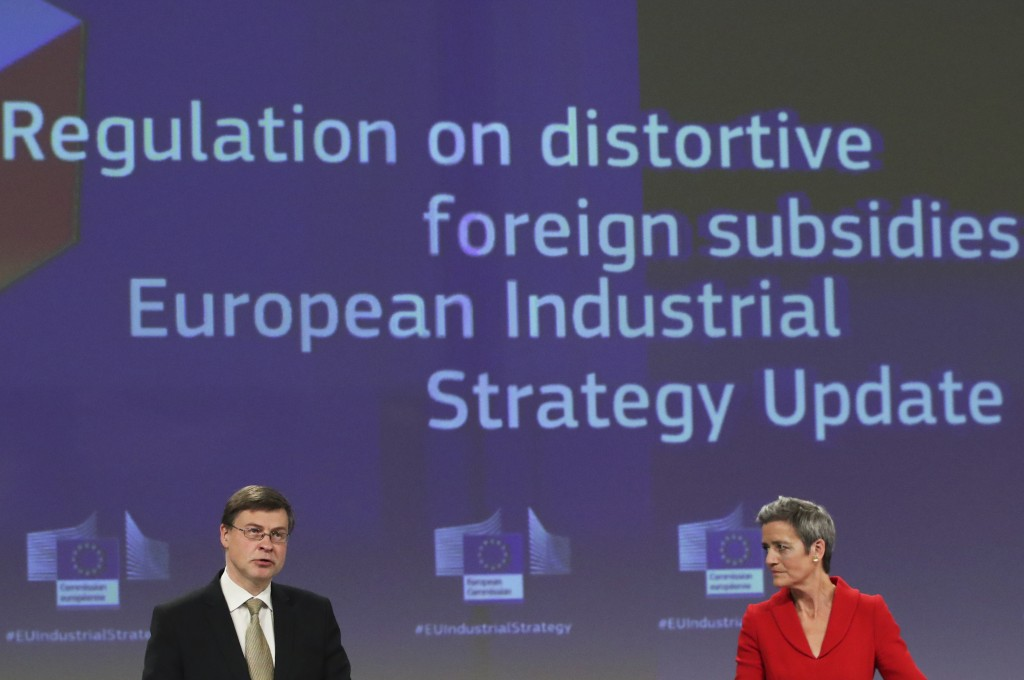 European Commission Vice Presidents Margrethe Vestager, right, and Valdis Dombrovskis participate in a media conference on the proposal for a Regulati...
