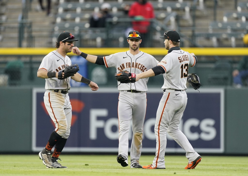 From left, San Francisco Giants left fielder Mike Tauchman, center fielder Steven Duggar and right fielder Austin Slater celebrate after the seventh i...