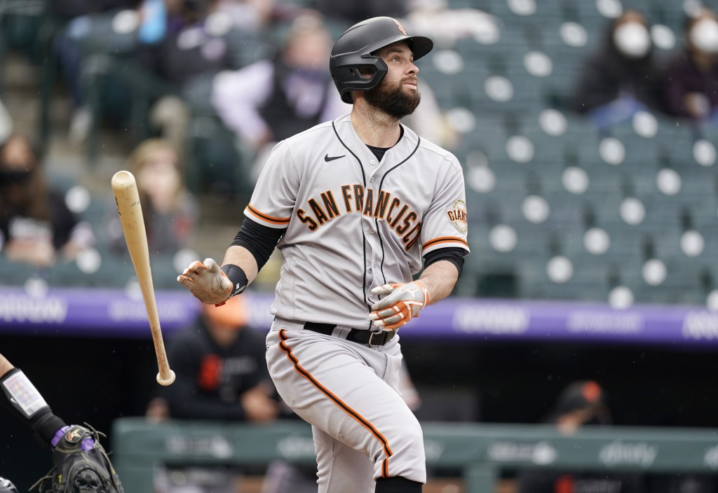 San Francisco Giants' Brandon Belt follows the flight of his three-run home run off Colorado Rockies relief pitcher Jhoulys Chacin in the first inning...