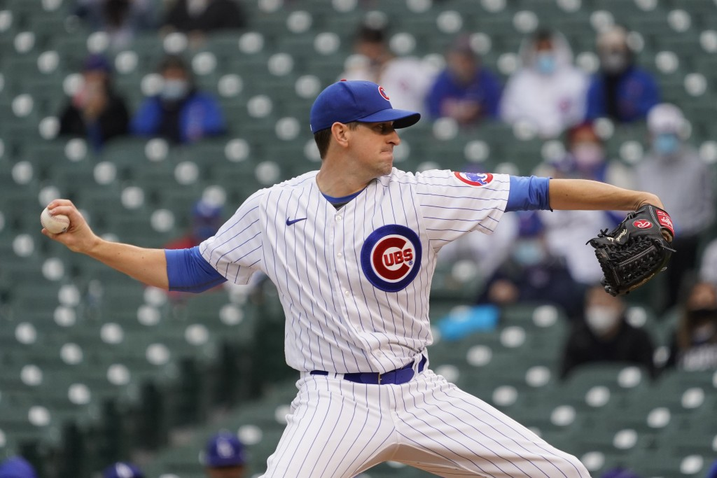 Chicago Cubs starting pitcher Kyle Hendricks throws the ball against the Los Angeles Dodgers during the first inning of the first baseball game of a d...