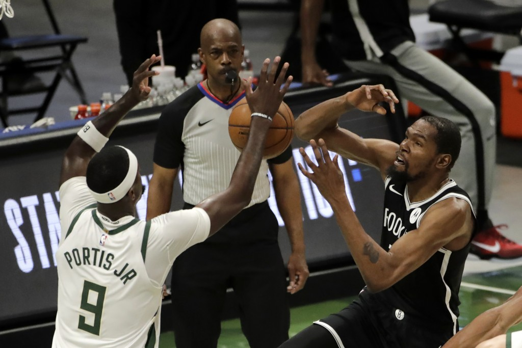 Brooklyn Nets' Kevin Durant is fouled as he shoots against Milwaukee Bucks' Bobby Portis (9) during the first half of an NBA basketball game Tuesday, ...