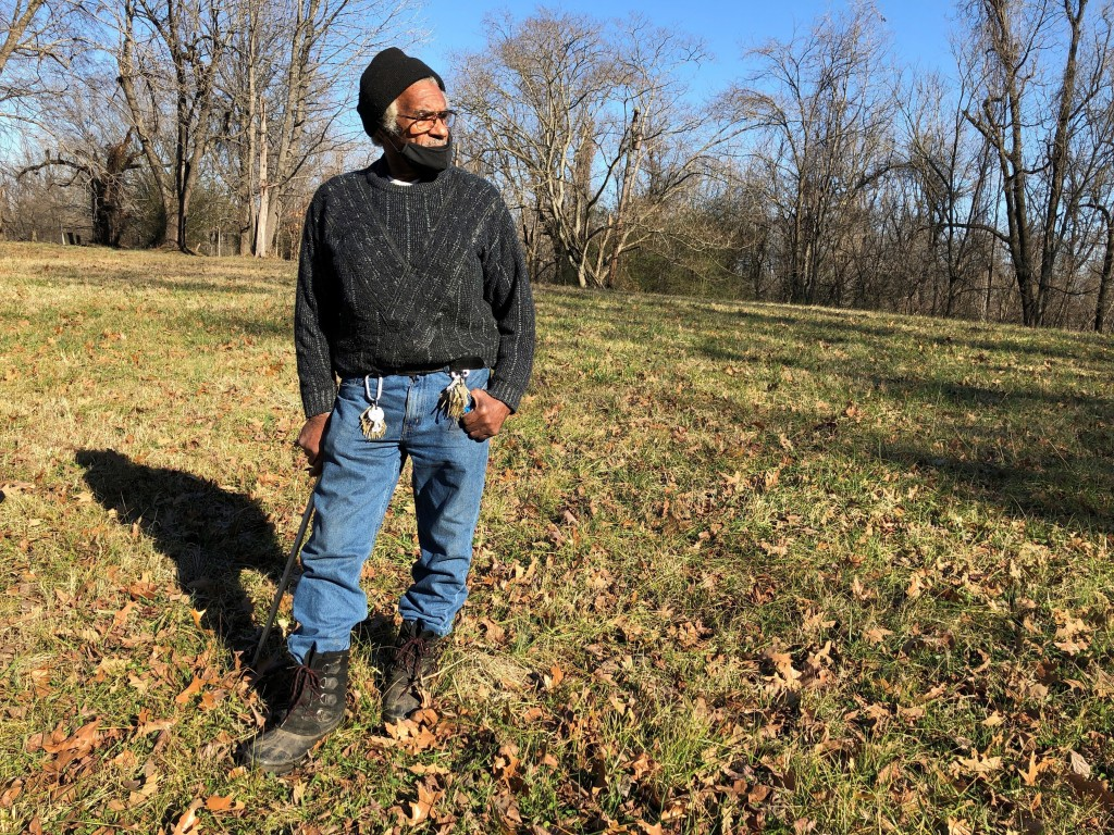 FILE - In this Jan. 28, 2021, file photo, Clyde Robinson, 80, speaks with a reporter while standing on his acre-sized parcel of land, in Memphis, Tenn...