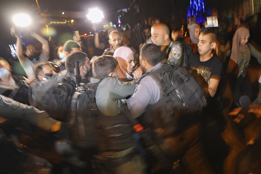 Palestinians scuffle with Israeli police officers during a protest against the planned evictions of Palestinian families in the Sheikh Jarrah neighbor...