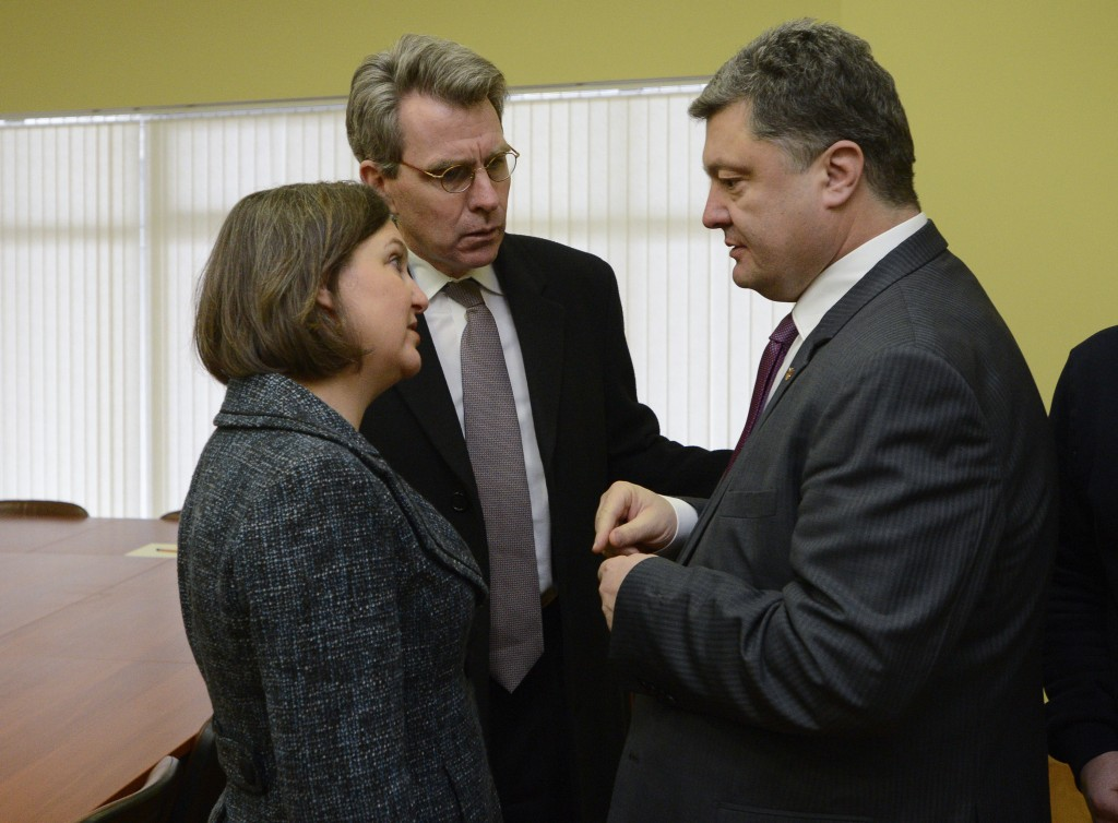 FILE - In this Dec. 10, 2013, file photo, U.S. Assistant Secretary for European and Eurasian Affairs Victoria Nuland, left, and U.S. Ambassador in Ukr...