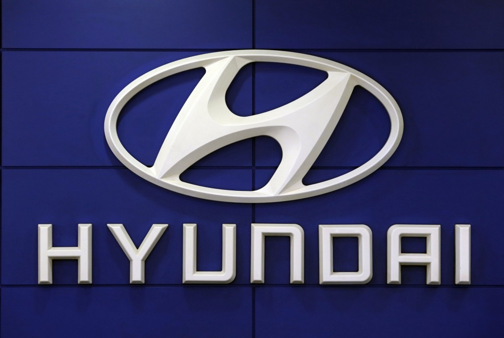 FILE - This July 26 2018 file photo shows the logo of Hyundai Motor Co. in Seoul, South Korea. Hyundai is recalling over 390,000 vehicles in the U.S. ...