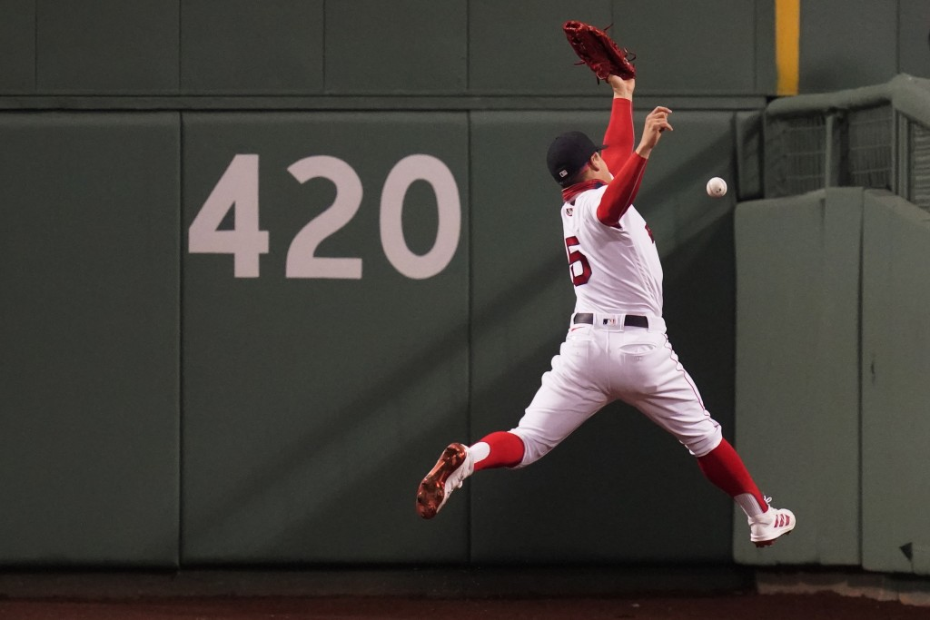 Boston Red Sox center fielder Enrique Hernandez leaps but can't make the play on an RBI double by Detroit Tigers' Robbie Grossman during the fifth inn...