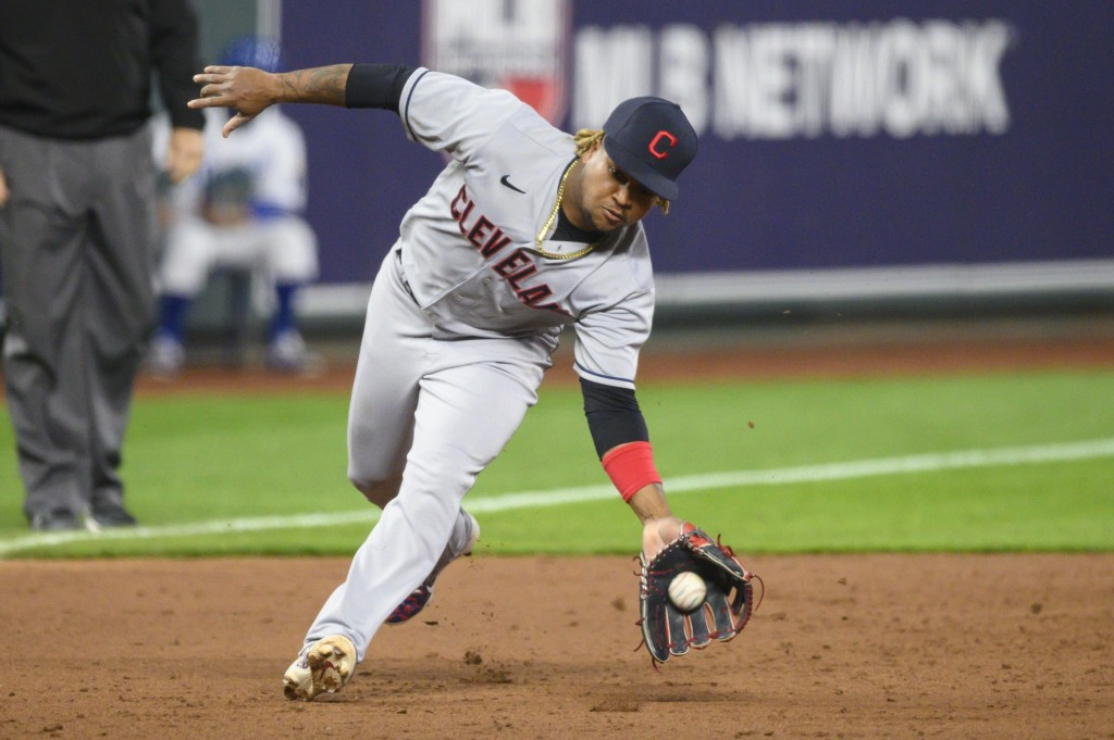 Cleveland Indians third baseman Jose Ramirez scoops up this grounder to throw out Kansas City Royals' Whit Merrifield for the third out in the sixth i...