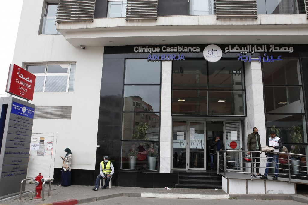 People wait in front of the Ain Borja private clinic in Casablanca, Morocco, Wednesday, May 5, 2021. A Malian woman has given birth to nine babies aft...