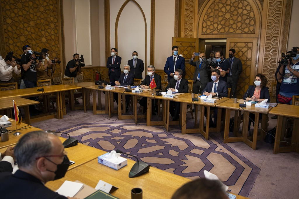 Turkish Foreign Ministry Deputy Sedat Onal, seated third right, meets with Hamdi Sanad Loza, Egyptian deputy foreign minister, and their delegations, ...