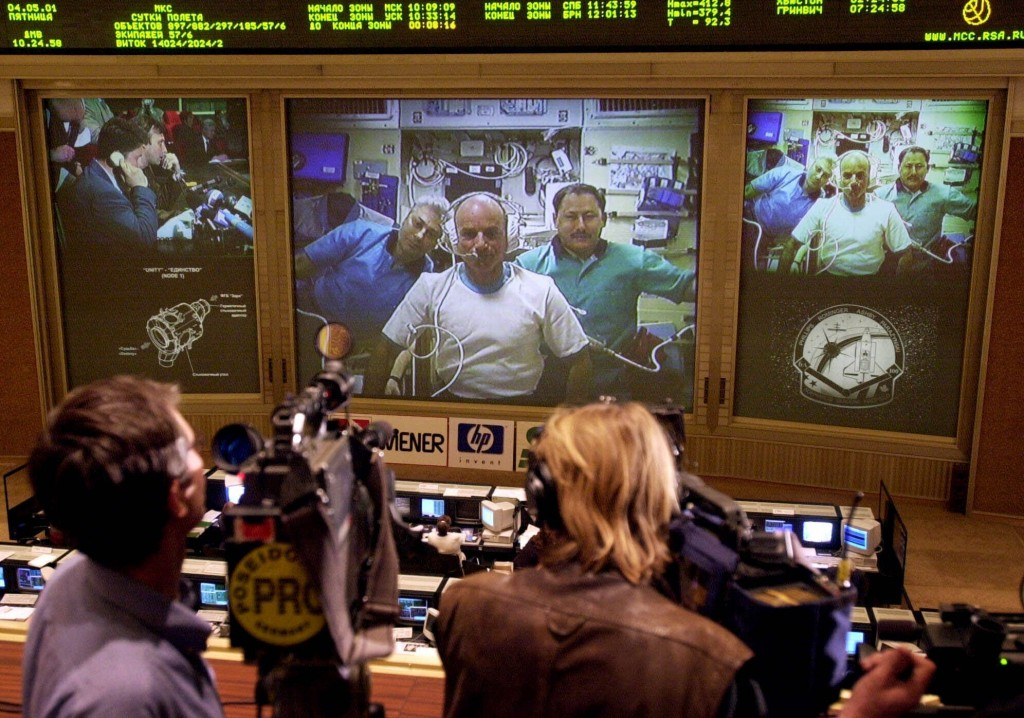 FILE - In this Friday, May 4, 2001 file photo, reporters and officials at the Mission Control Center in Korolev, Russia, outside Moscow, watch U.S. sp...