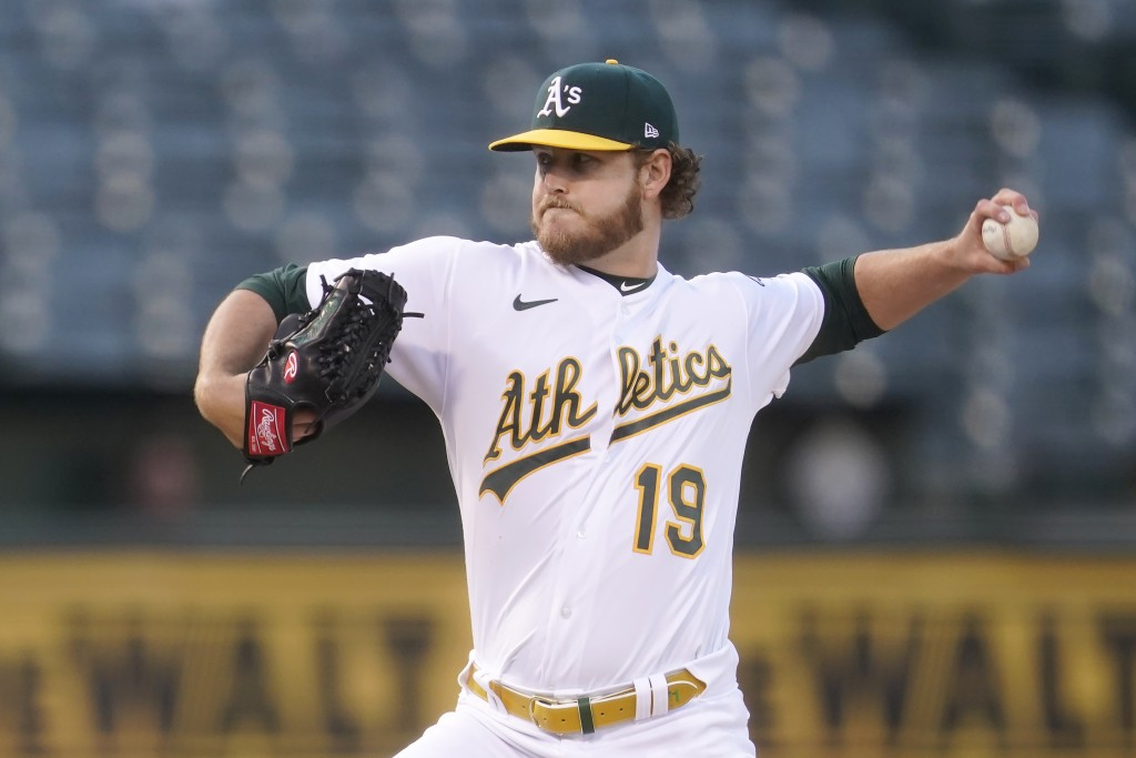 Oakland Athletics' Cole Irvin (19) pitches against the Toronto Blue Jays during the first inning of a baseball game in Oakland, Calif., Tuesday, May 4...
