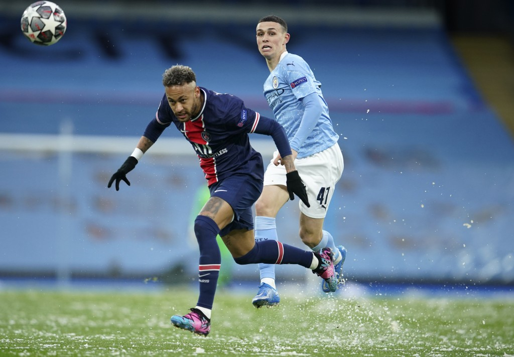 Manchester City's Phil Foden, right, challenges PSG's Neymar during the Champions League semifinal second leg soccer match between Manchester City and...