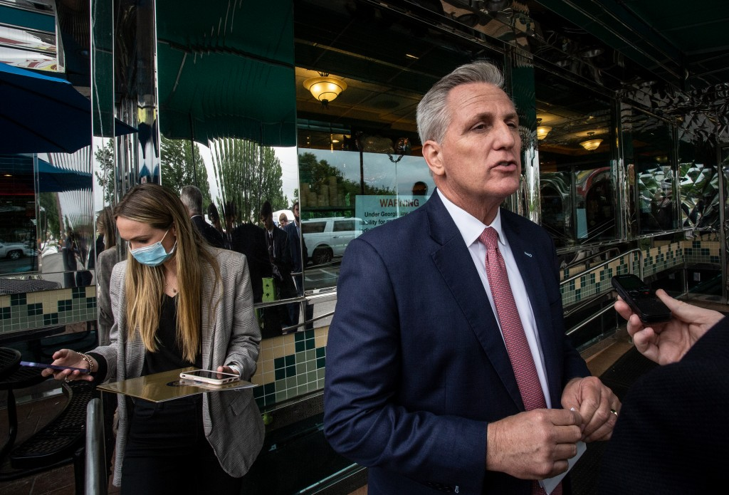House Minority Leader Kevin McCarthy, R-Calif., speaks to a reporter outside a diner on Monday, May 4, 2021, in Marietta, Ga. McCarthy and other Repub...