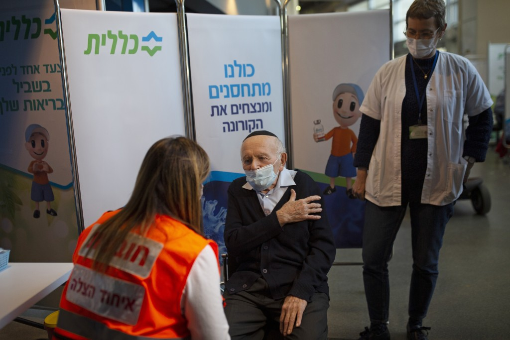 FILE - In this Jan. 21, 2021 file photo, Holocaust survivor Joseph Zalman Kleinman gestures to the arm he prefers to receive the second dose of the Pf...