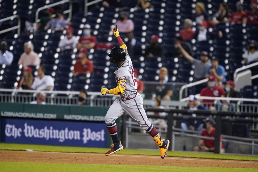 Atlanta Braves' Ronald Acuña Jr. runs the bases for his solo home run during the fifth inning of baseball game against the Washington Nationals at Nat...