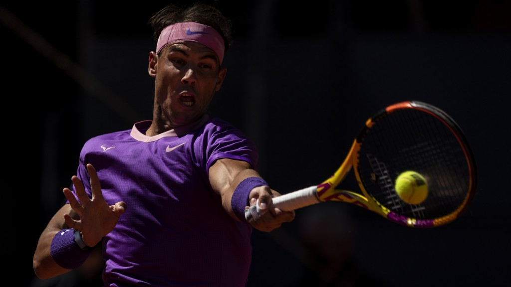Spain's Rafael Nadal returns the ball to Spain's Carlos Alcaraz during their match at the Mutua Madrid Open tennis tournament in Madrid, Spain, Wednes...