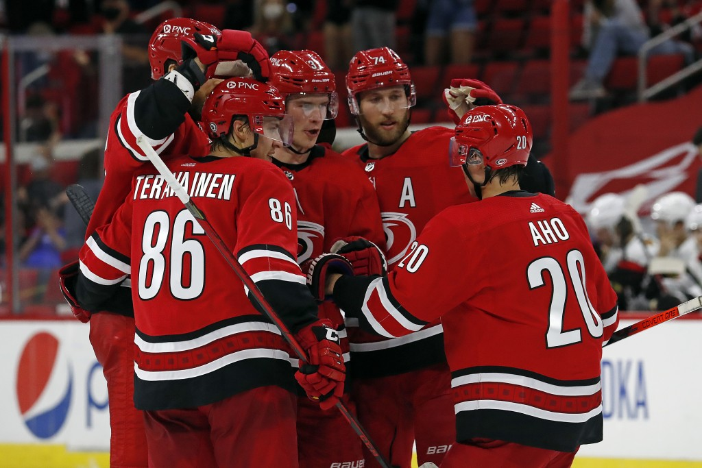 Carolina Hurricanes' Andrei Svechnikov, center, is congratulated on his goal by teammates during the second period of an NHL hockey game against the C...