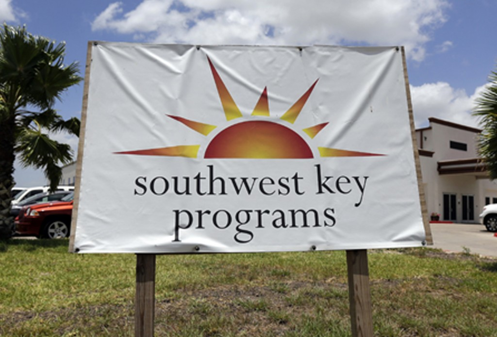 This June 20, 2014, file photo shows a Southwest Key Programs sign in Brownsville, Texas. The U.S. Department of Health and Human Services has awarded...