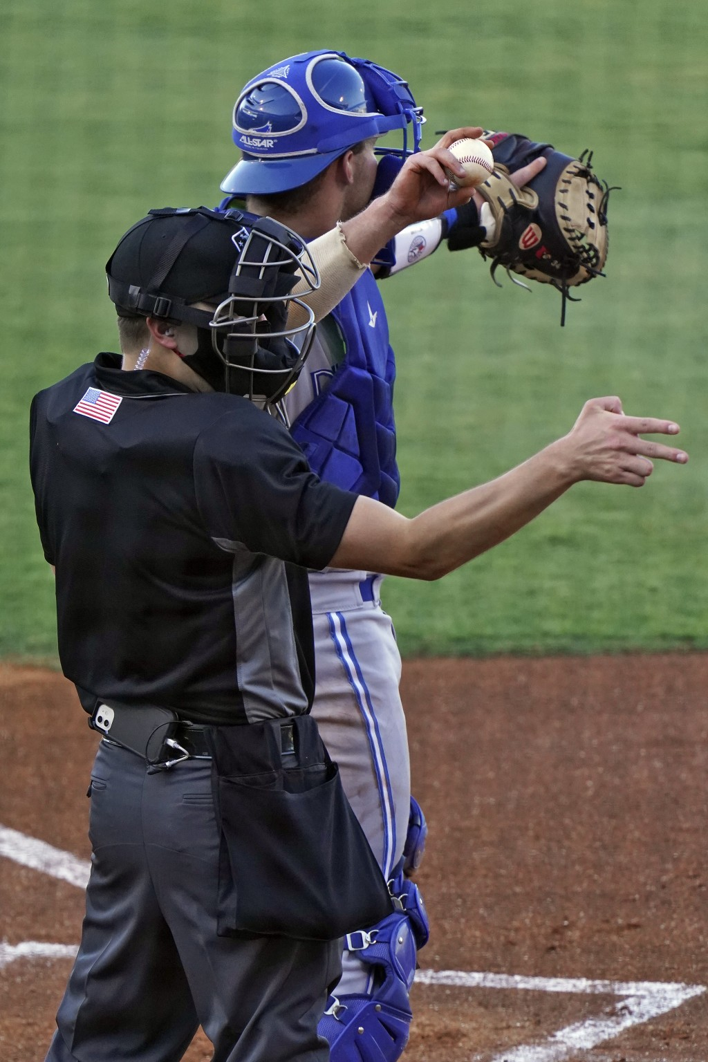 Home plate umpire Kaleb Devier calls a strike during a Low A Southeast League baseball game between the Dunedin Blue Jays and the Tampa Tarpons at Geo...