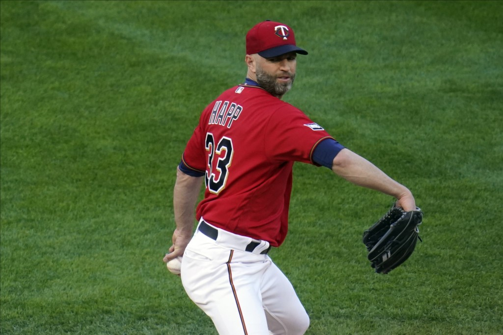 Minnesota Twins' pitcher J.A. Happ throws against the Texas Rangers in the first inning of a baseball game, Tuesday, May 4, 2021, in Minneapolis. (AP ...