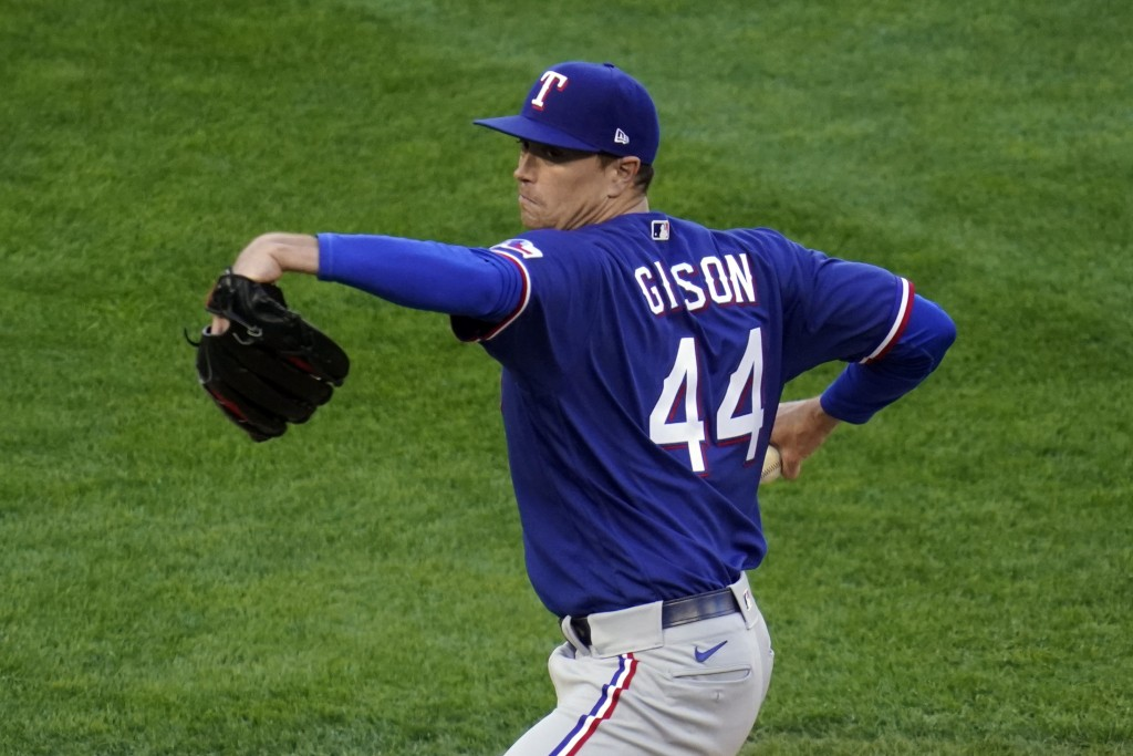 Texas Rangers' pitcher Kyle Gibson (44) throws against the Minnesota Twins in the first inning of a baseball game, Tuesday, May 4, 2021, in Minneapoli...
