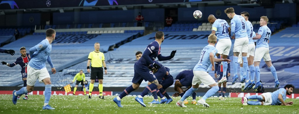 Manchester City's player try to block a free kick by PSG's Neymar, left, during the Champions League semifinal second leg soccer match between Manches...