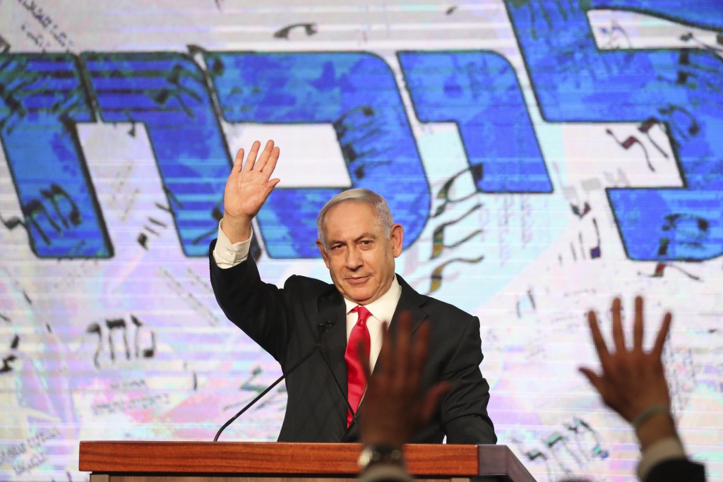 FILE - In this Wednesday, March 24, 2021, file photo, Israeli Prime Minister Benjamin Netanyahu waves to his supporters after the first exit poll resu...