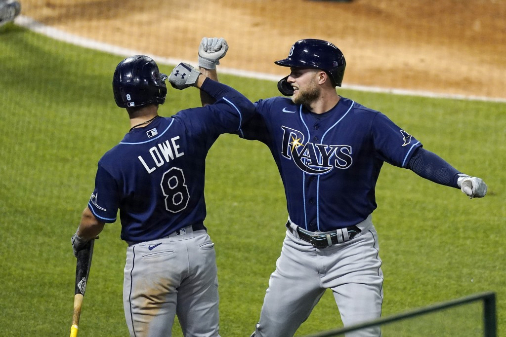 Tampa Bay Rays' Austin Meadows, right, is congratulated by Brandon Lowe hits a solo home run during the seventh inning of a baseball game against the ...