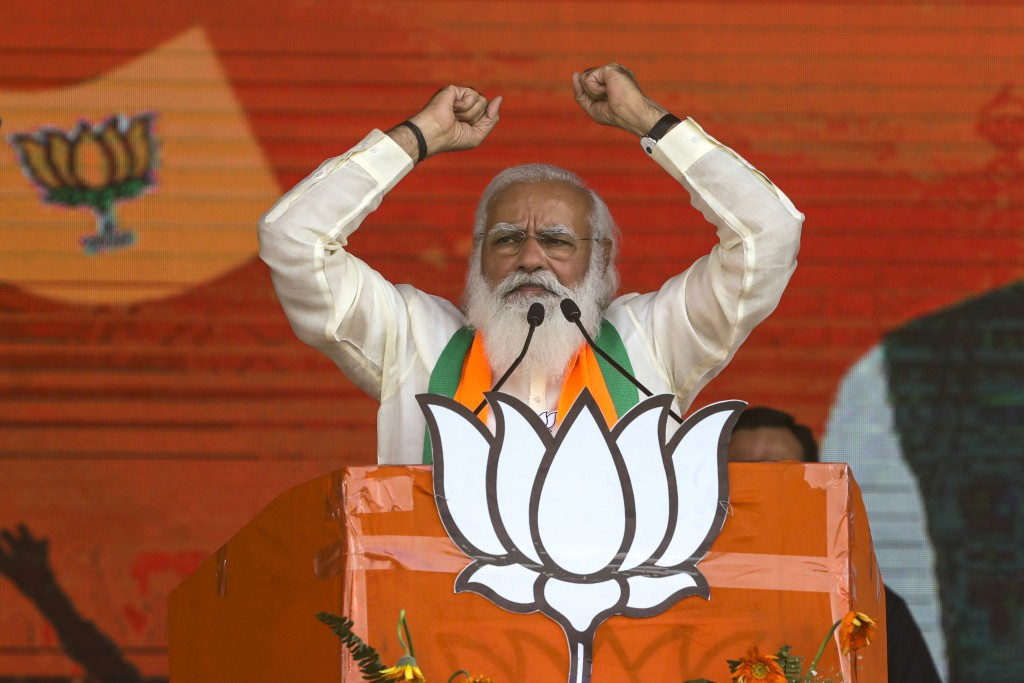 FILE - In this March 7, 2021, file photo, Indian Prime Minister Narendra Modi addresses a public rally ahead of West Bengal state elections in Kolkata...