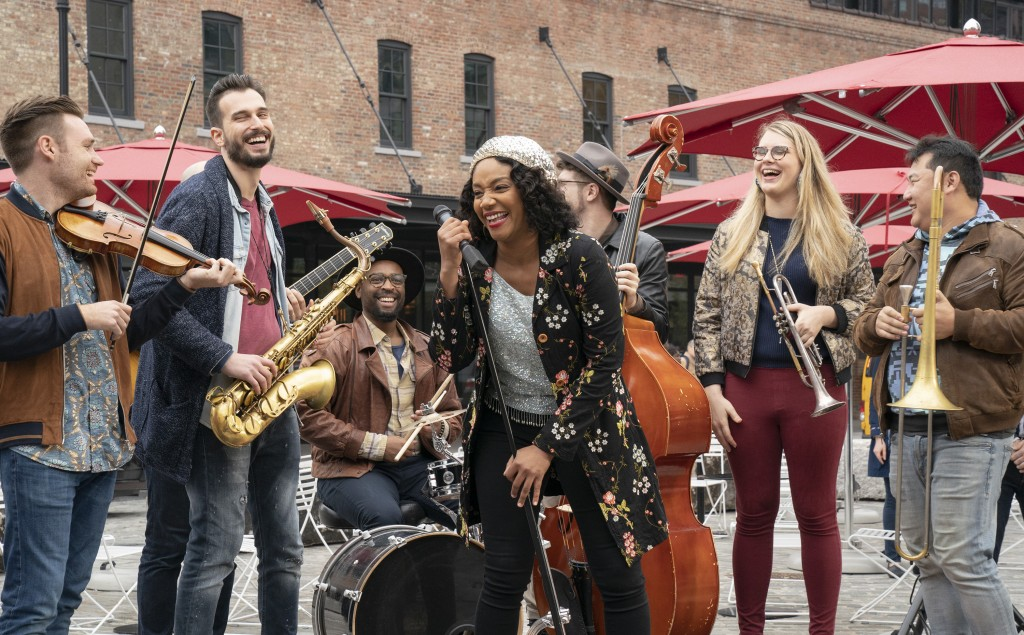 """This image released by Sony Pictures shows Tiffany Haddish, center, in a scene from """"Here Today."""" (Cara Howe/Sony Pictures via AP)"""