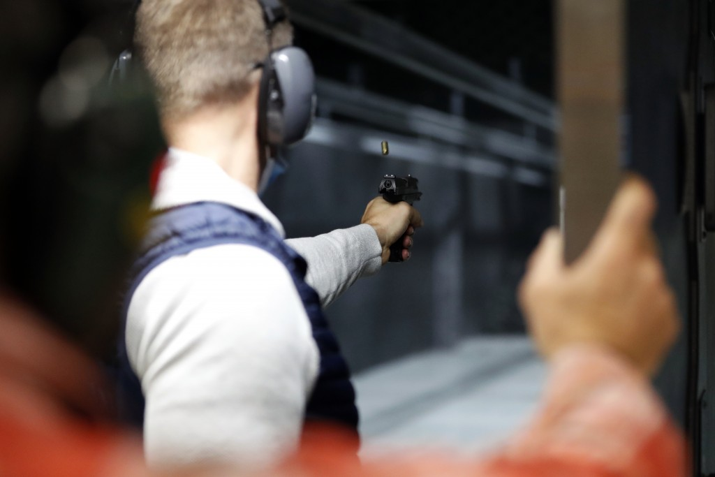 Chicago resident Ray Mandel practices shooting during a session at Maxon Shooter's Supplies and Indoor Range, Friday, April 30, 2021, in Des Plaines, ...
