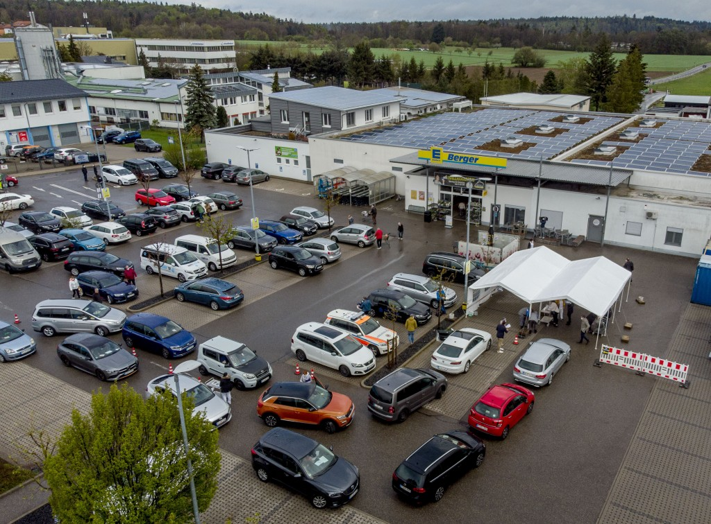 Cars with people waiting for AstraZeneca vaccination queue in front of a tent on the parking lot of a supermarket in Pforzheim, southern Germany, Wedn...