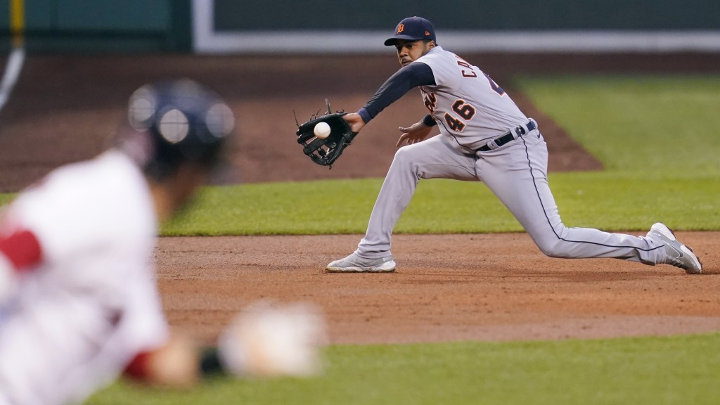 Detroit Tigers third baseman Jeimer Candelario (46) fields a grounder by Boston Red Sox designated hitter J.D. Martinez during the first inning of a b...