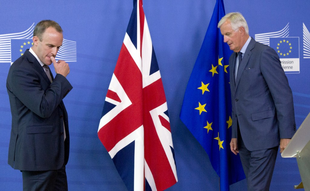 FILE - In this Friday, Aug. 31, 2018 file photo Britain's Secretary of State for Exiting the European Union Dominic Raab, left, and EU chief Brexit ne...