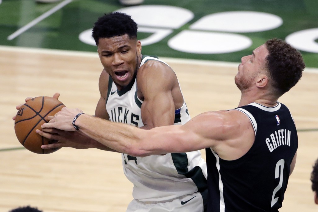 Milwaukee Bucks' Giannis Antetokounmpo drives to the basket against Brooklyn Nets' Blake Griffin during the first half of an NBA basketball game Tuesd...
