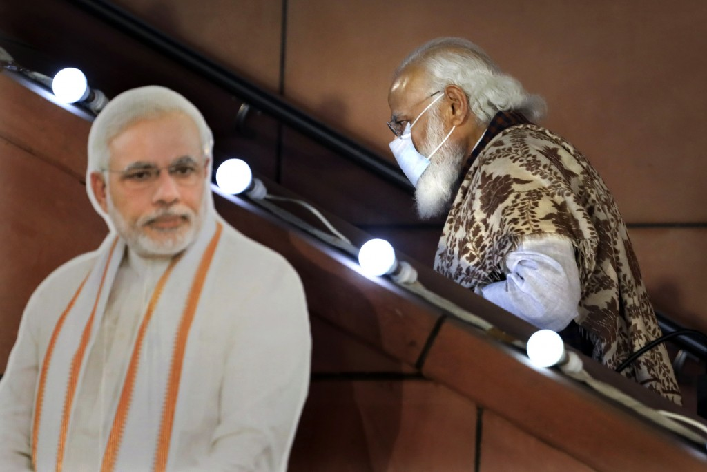 FILE - In this Nov. 11 2020, file photo, Indian Prime Minister Narendra Modi leaves after a function at the Bharatiya Janata Party headquarters follow...