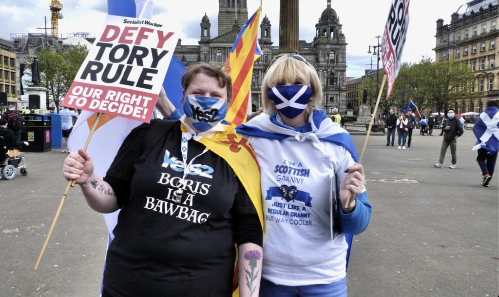 Scottish independence supporters attend a rally in Glasgow, Scotland, Saturday, May 1, 2021. Scotland holds an election Thursday that could hasten the...