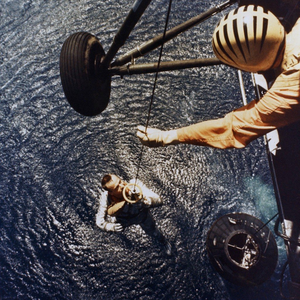 In this May 5, 1961 photo made available by NASA, astronaut Alan Shepard is retrieved by a U.S. Marine helicopter after splashdown in the Atlantic Oce...