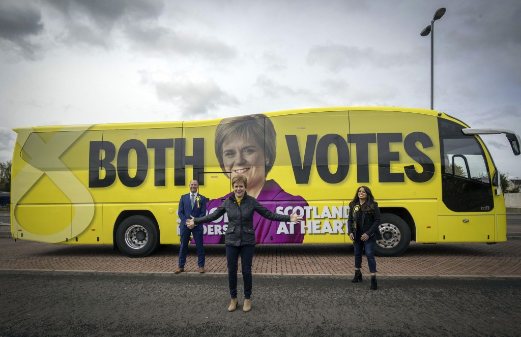 First Minister of Scotland and leader of the SNP Nicola Sturgeon, with party candidates Neil Gray, left, and Anum Qaisar-Javed, right, alongside the p...