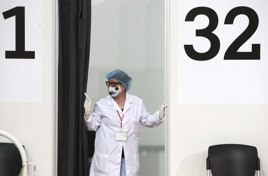 A nurse waits at a vaccination booth, in the center for vaccination against COVID-19, at A1 Arena in Skopje, North Macedonia, on Tuesday, May 4, 2021....