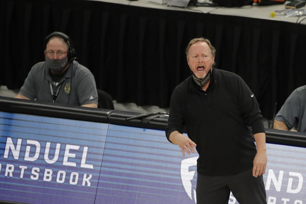Milwaukee Bucks head coach Mike Budenholzer shouts from the sideline during the first half of an NBA basketball game against the Brooklyn Nets Tuesday...
