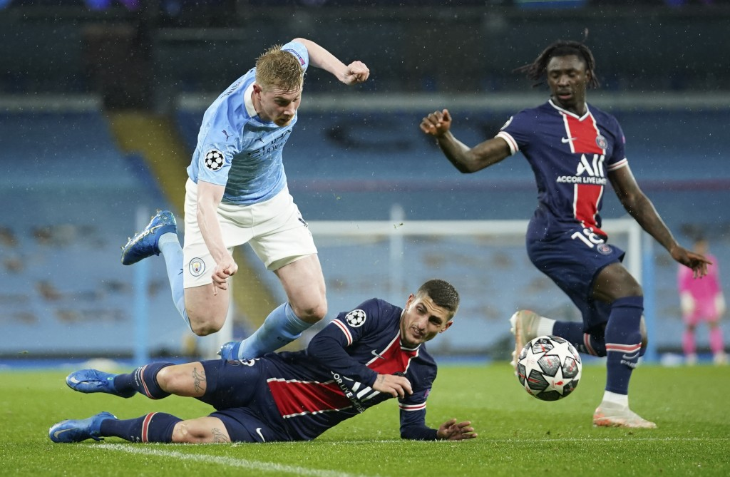 PSG's Marco Verratti, center, and PSG's Moise Kean, right, challenge Manchester City's Kevin De Bruyne during the Champions League semifinal second le...