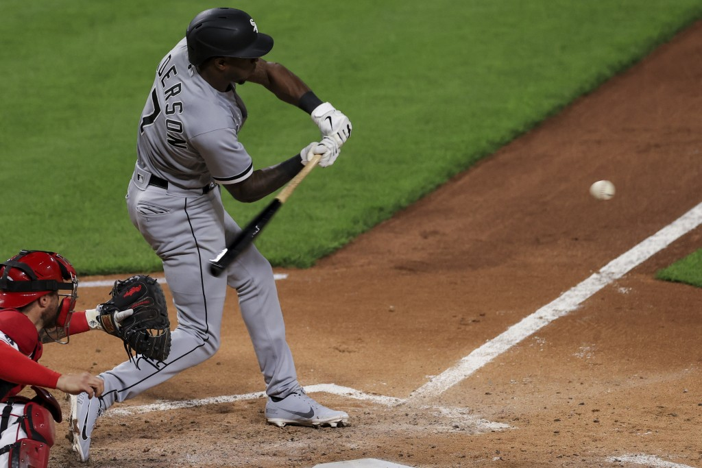 Chicago White Sox Tim Anderson hits an RBI single during the fourth inning of a baseball game against the Cincinnati Reds, Tuesday, May 4, 2021 in Cin...