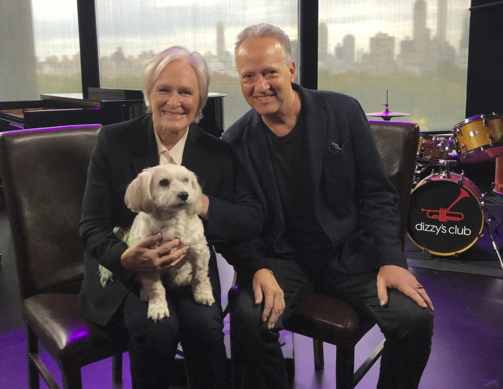 Actress-singer Glenn Close holds Pip as she poses with Ted Nash at Jazz at Lincoln Center's Dizzy's Club in New York on Nov. 7, 2019. On Friday the pa...