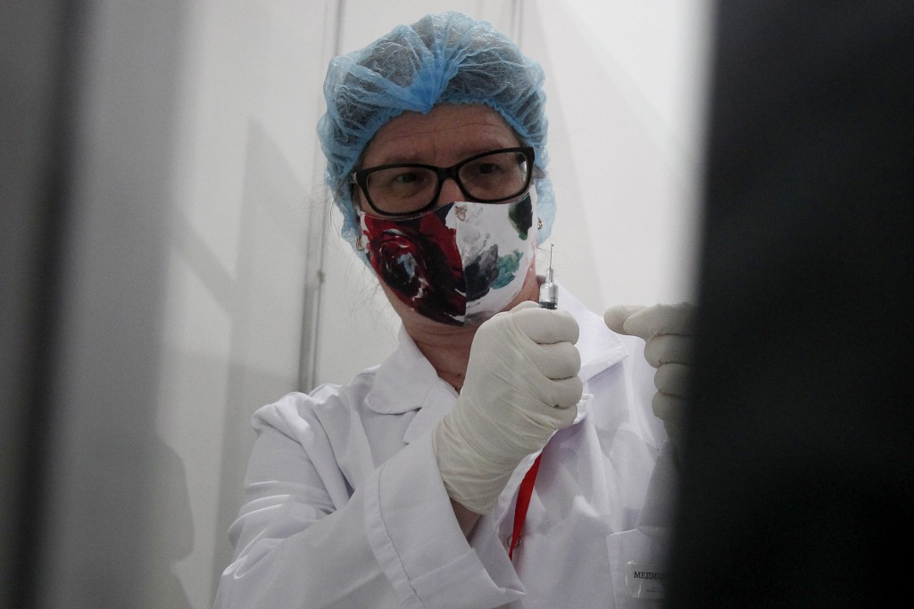 A nurse prepares a COVID-19 vaccine, at the center for mass vaccination against COVID-19, at A1 Arena in Skopje, North Macedonia, on Tuesday, May 4, 2...