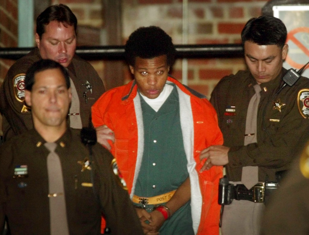 FILE - Sniper shooting suspect John Lee Malvo is escorted from court after his preliminary hearing in Fairfax, Va., on Jan. 14, 2003. An eight-episode...
