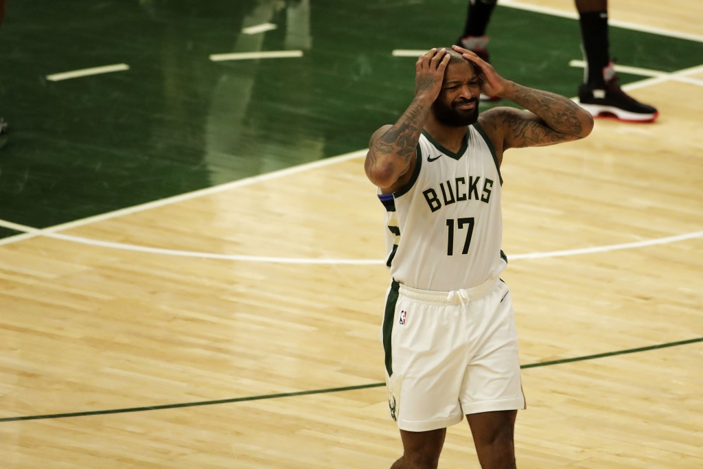 Milwaukee Bucks' P.J. Tucker reacts to a call during the first half of an NBA basketball game against the Brooklyn Nets Tuesday, May 4, 2021, in Milwa...