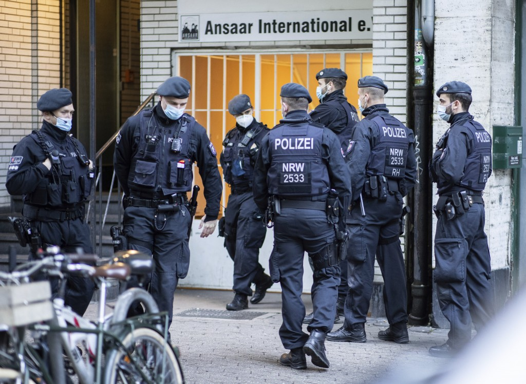 Police officers stay in front of a building of the Ansaar International association in Duesseldorf, Germany, Wednesday, May 5. 2021. The German govern...